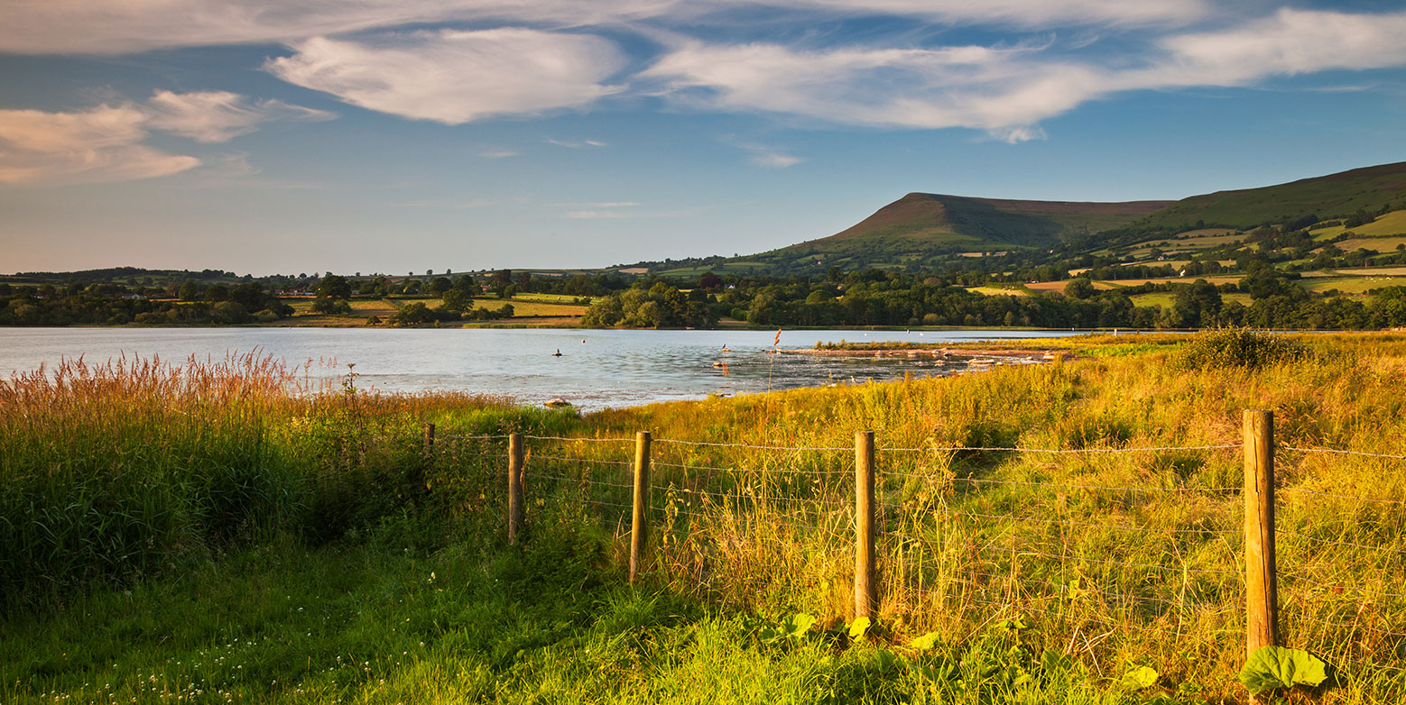 Llangorse Lake is in a spectacular location 	Llangorse lake is in a spectacular location